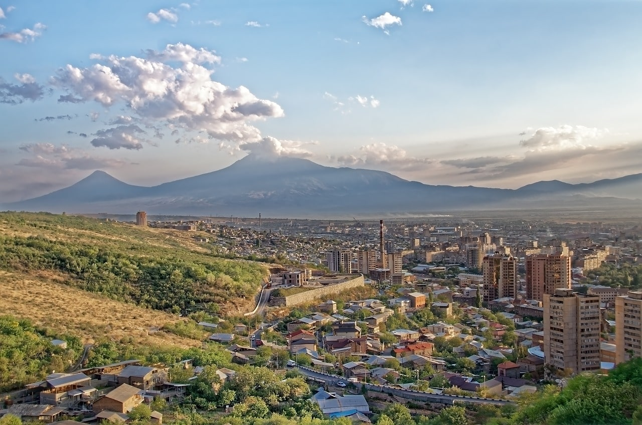a view of Yerevan Armenia with the city and the mountains in the distance