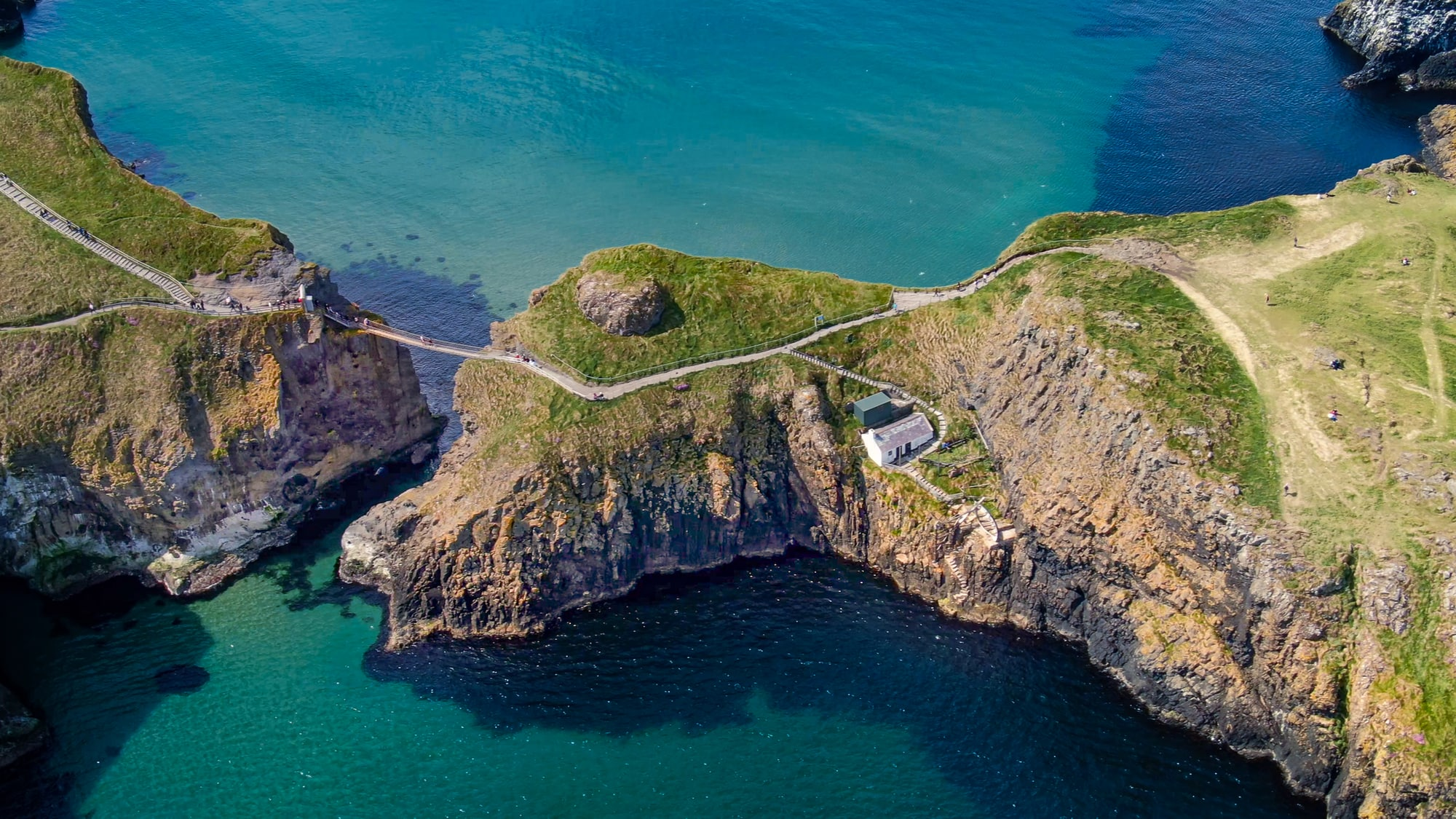 view from the sky of the Carrick-a-Rede rope bridge in N. Ireland