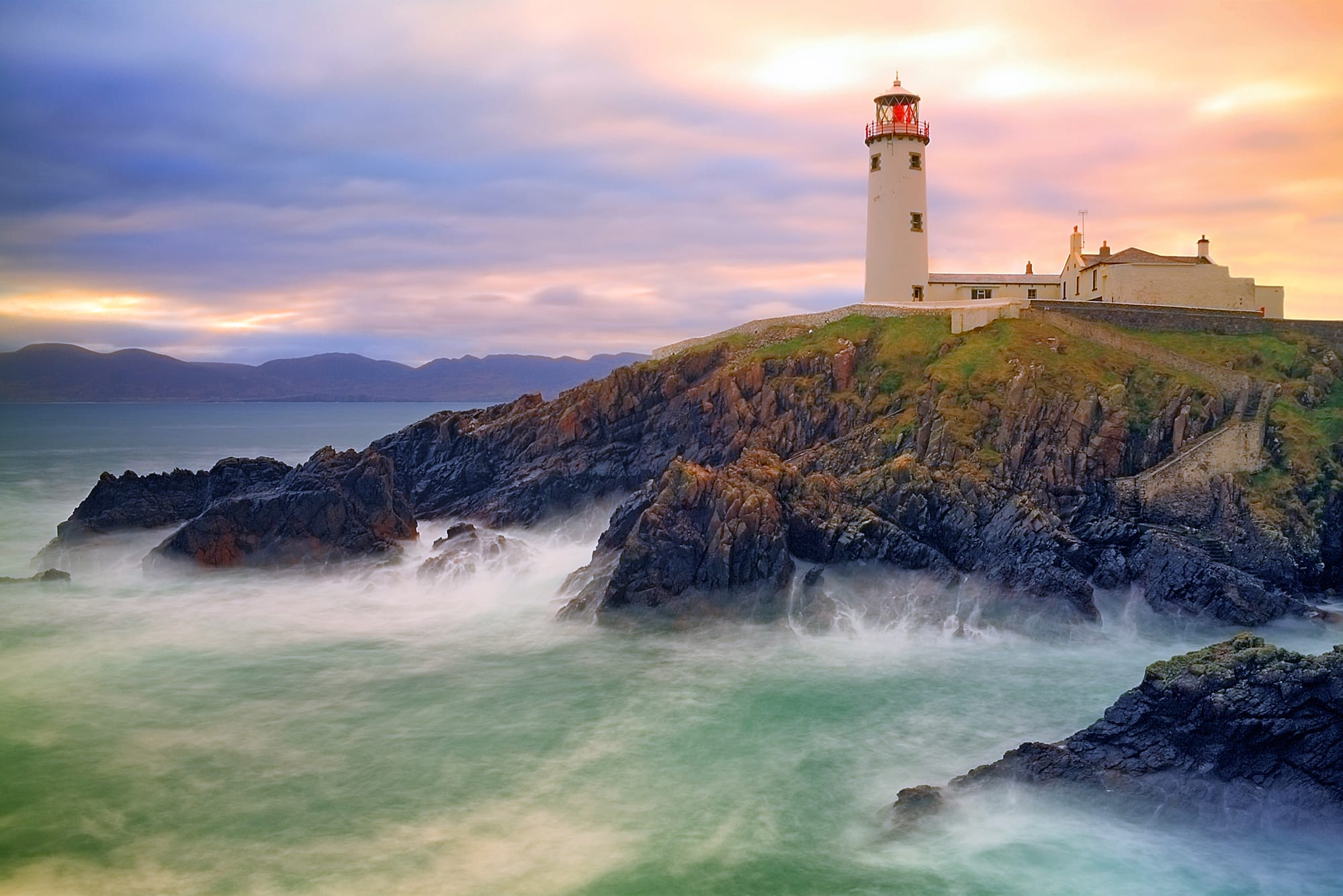 Fanad Lighthouse sits on cliffs above stormy bay, Co. Donegal, Ireland