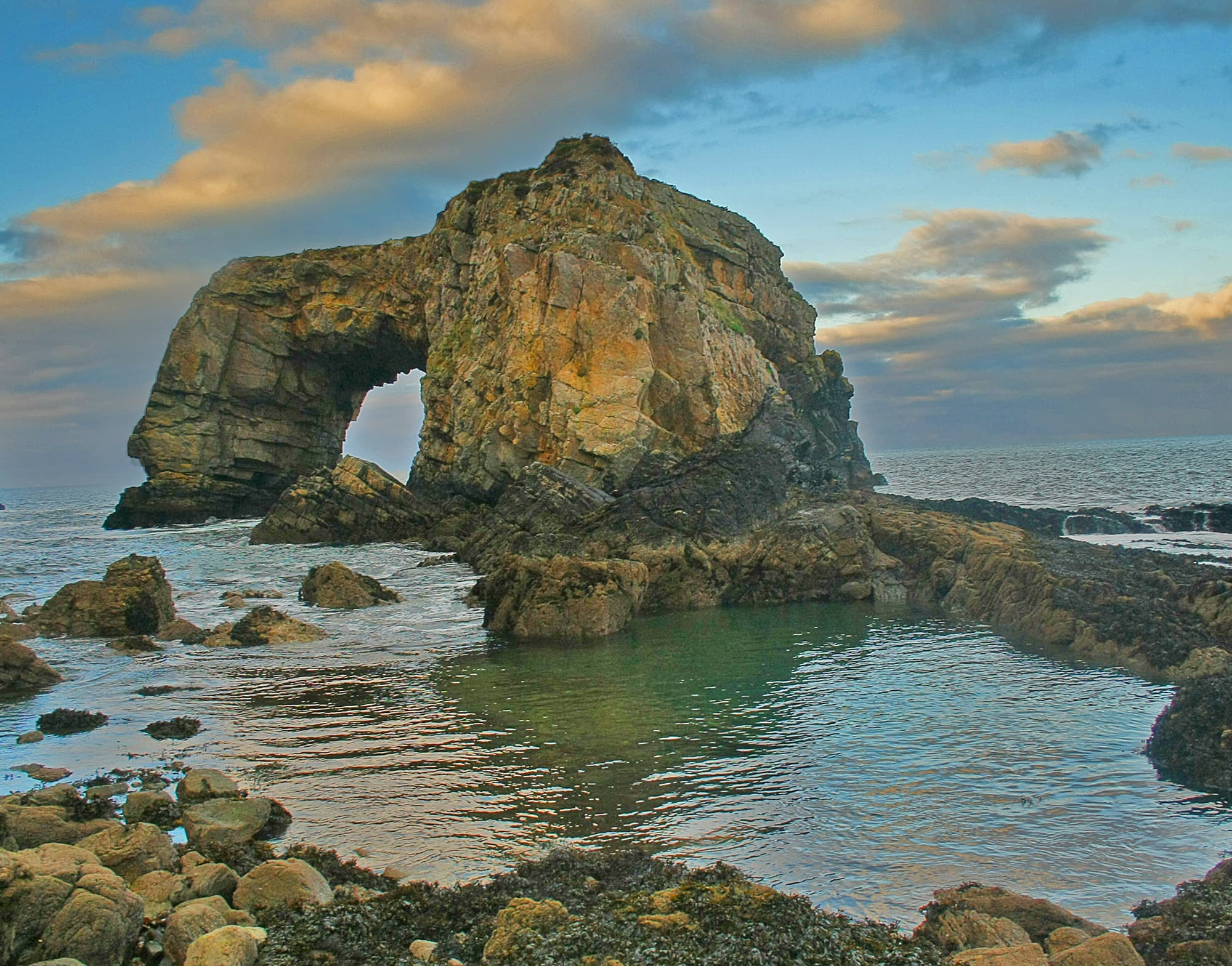 The Great Pollet Sea Arch, with dramatic skies at Fanad, Co. Donegal, Ireland