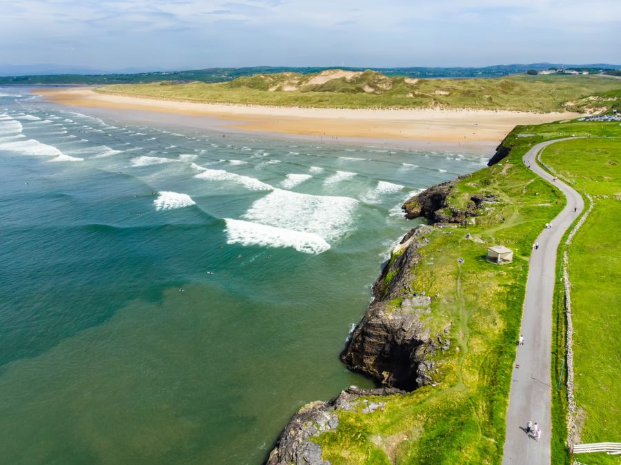 Spectacular Tullan Strand, one of Donegal's renowned surf beaches, framed by a scenic back drop provided by the Sligo-Leitrim Mountains. Wide flat sandy beach in County Donegal,