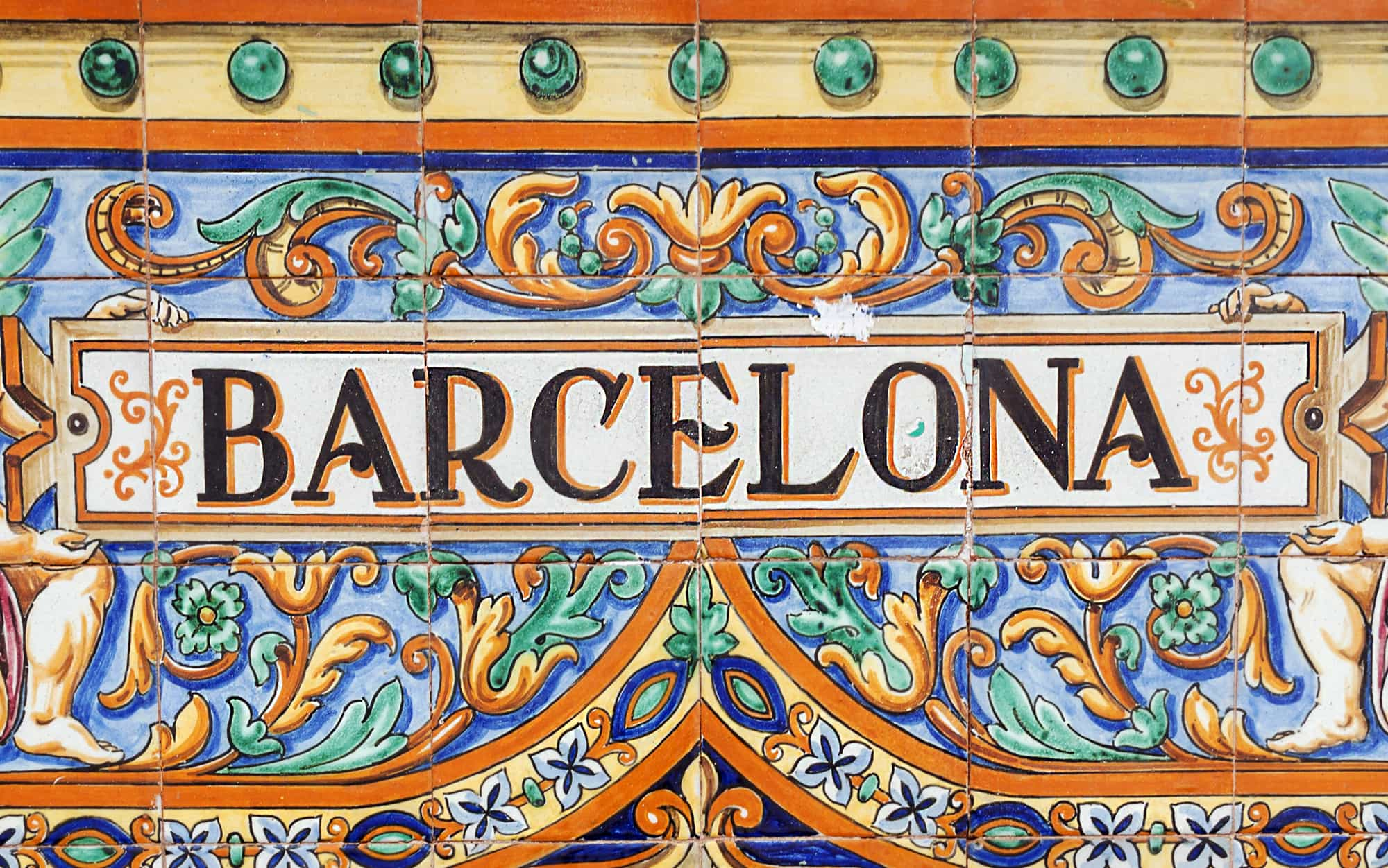 A tile placque spelling out Barcelona in bright colours one day in Barcelona