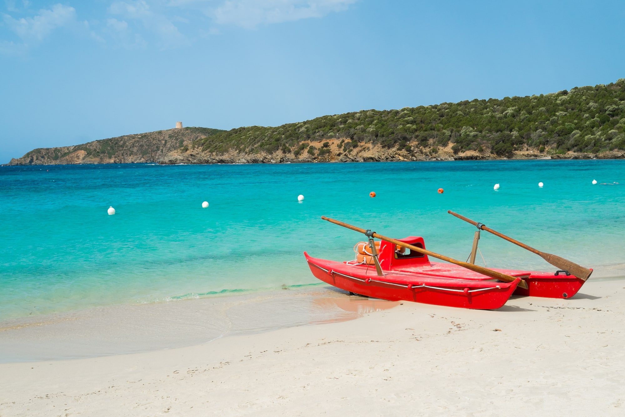 Red rowboat on Tuerredda beach along the coast of Teulada, South Sardinia, Italy