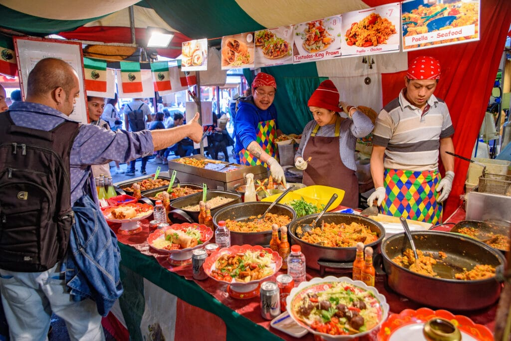 Food stalls in Brick Lane Sunday Market in London, United Kingdom