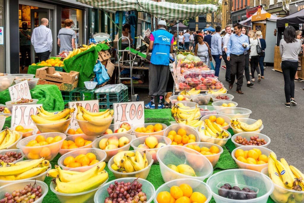 London, United Kingdom - July 22, 2016: Leather Lane Street Market - street in Holborn with great streetfood, fruit and vegetables and clothes stalls, very popular with office workers Monday to Friday