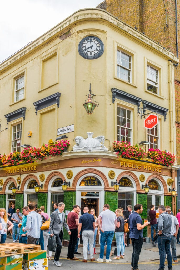 London, United Kingdom - July 22, 2016: Pub at Leather Lane Street Market - street in Holborn with great streetfood, fruit and vegetables and clothes stalls, very popular with office workers Monday to Friday
