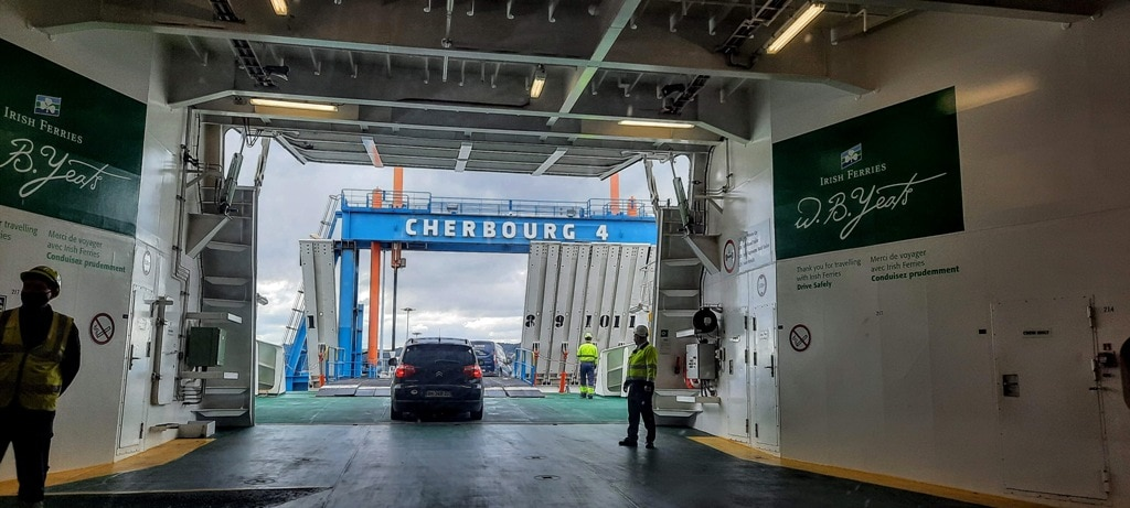 Travelling to France the ferry from Dublin to Cherbourg, cars getting off the ferry once in port.