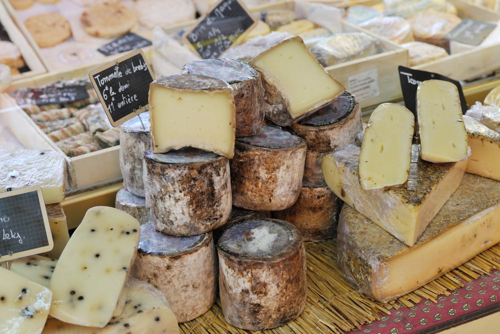 Random types of yellow french cheese at Provence market