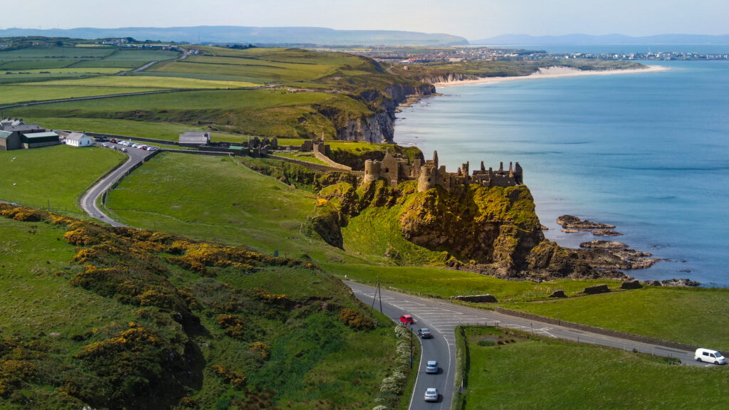 Aerial view over famous Dunluce Castle in North Ireland - travel photography