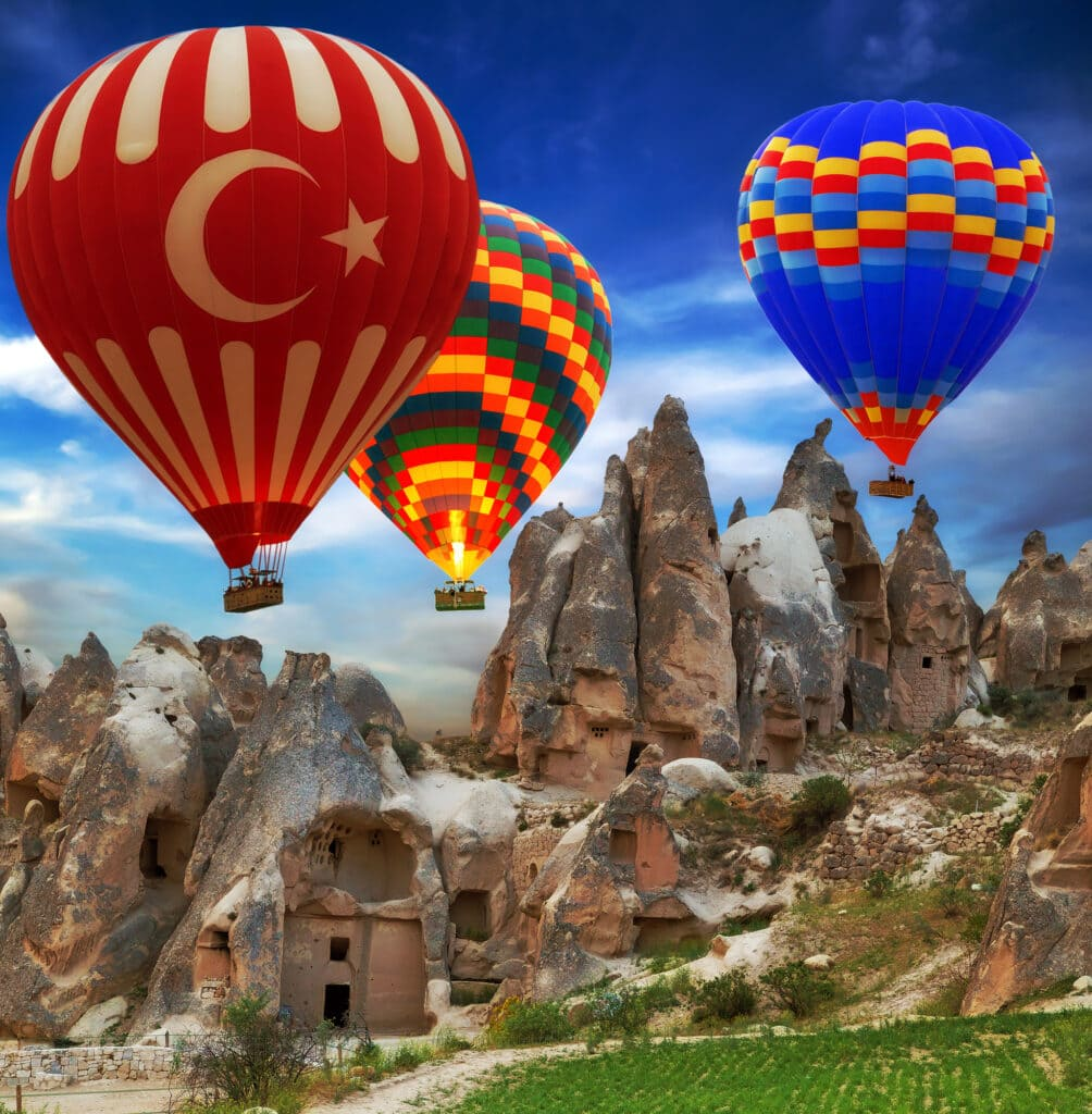 Hot air balloon turkey flag flying mountain valley Cappadocia Turkey - how to spend 3 days in Cappadocia