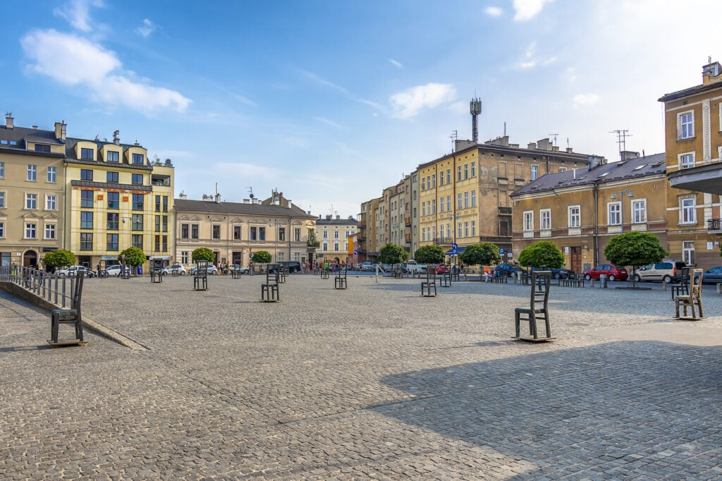 Krakow, Poland June 5, 2018: Memorial to Jews from the Krakow Ghetto on their deportation site on the Ghetto Heroes Square in Podgorze district . Each steel chair represents 1,000 victims.